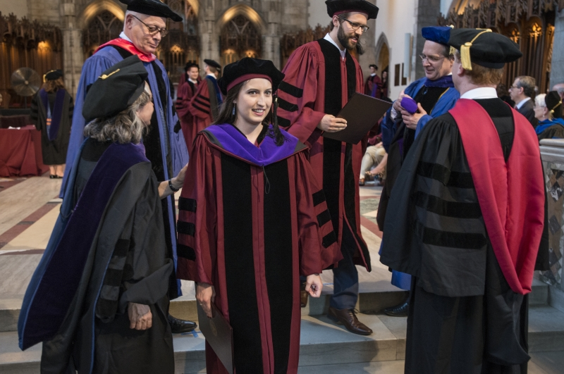 Carmel Dooling, '17, was hooded by Emily Buss, Mark and Barbara Fried Professor of Law, and Saul Levmore, William B. Graham Distinguished Service Professor of Law.
