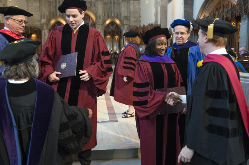 Jonathan Masur, John P. Wilson Professor of Law, and Douglas Baird, Harry A. Bigelow Distinguished Service Professor of Law, also hooded graduates.
