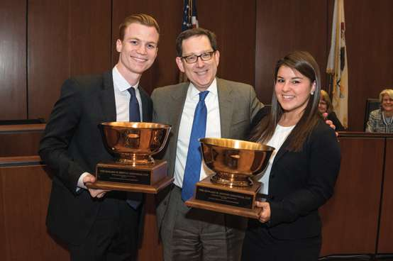 Dean Schill posing with Moot Court winners