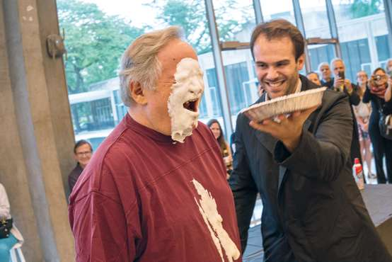 Dean Badger getting a pie in the face