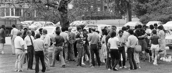 Faculty and students mingle at a 1970s picnic.