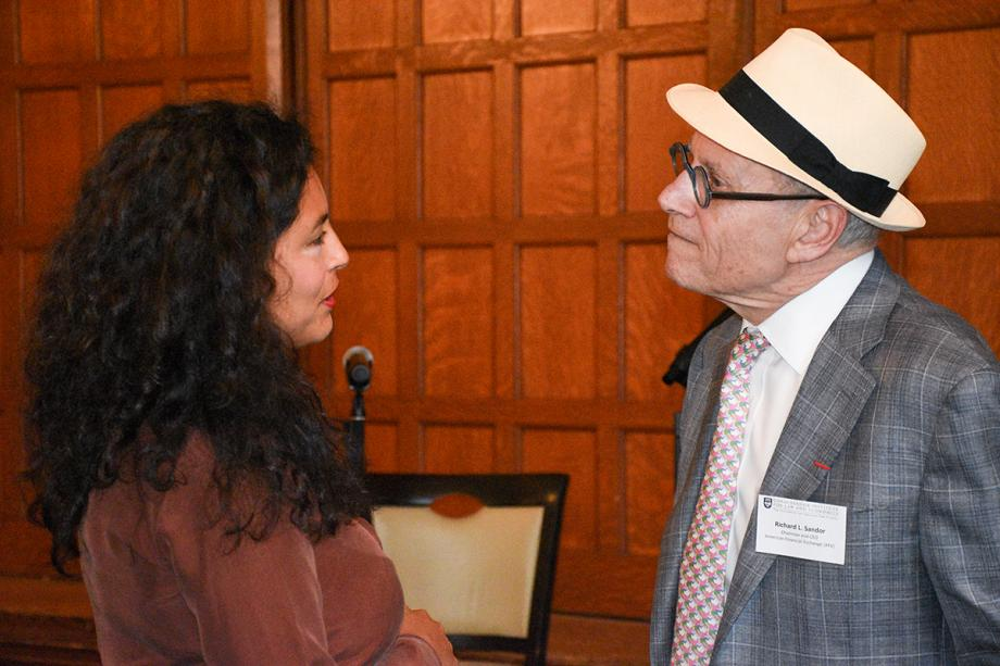 """The intellectual environment at the Summer Institute makes this experience exceptional,"" said Vanessa Villanueva Collao, a scholar from Peru [shown talking to Sandor]. ""After classes, we had the opportunity to have lunch with distinguished professors and have long discussions about Law and Economics. I have met scholars and practitioners from all over the world, which enriched my knowledge about the multiple applications of this methodology."""