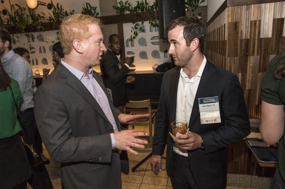 Professor Jonathan Masur talks with Nick Spear, '14, at the Class of 2014 dinner.