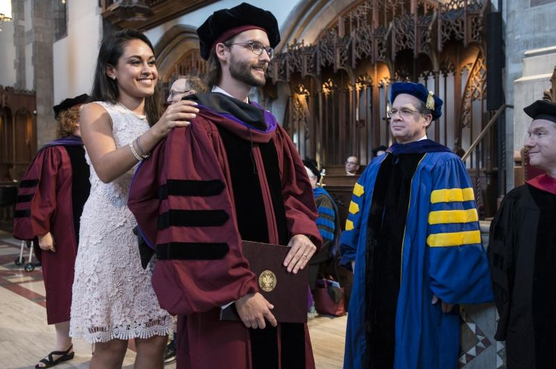 Kristoffer Gredsted, '17, received his hood from his wife, Monica Norzagary Pedraza, LLM '14.