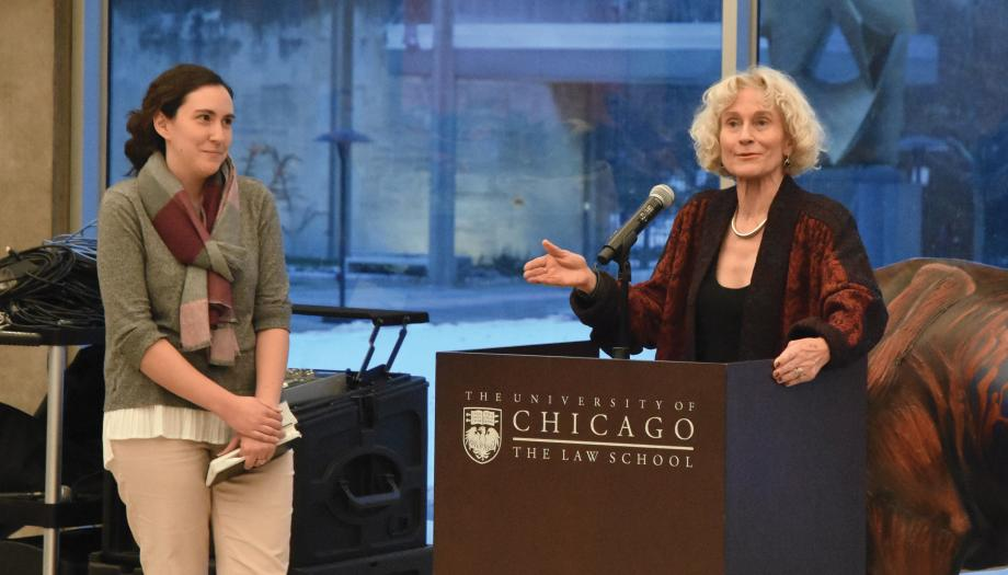 Faith Laken standing next to Martha Nussbaum at the lectern