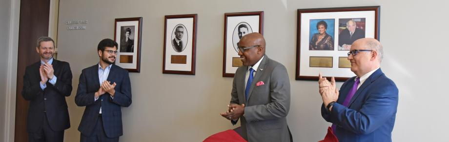 Dean Thomas J. Miles; Adam Hassanein, '21; Illinois Attorney General Kwame Raoul; and Deputy Dean Richard McAdams at the unveiling of the Nelson Willis photograph.