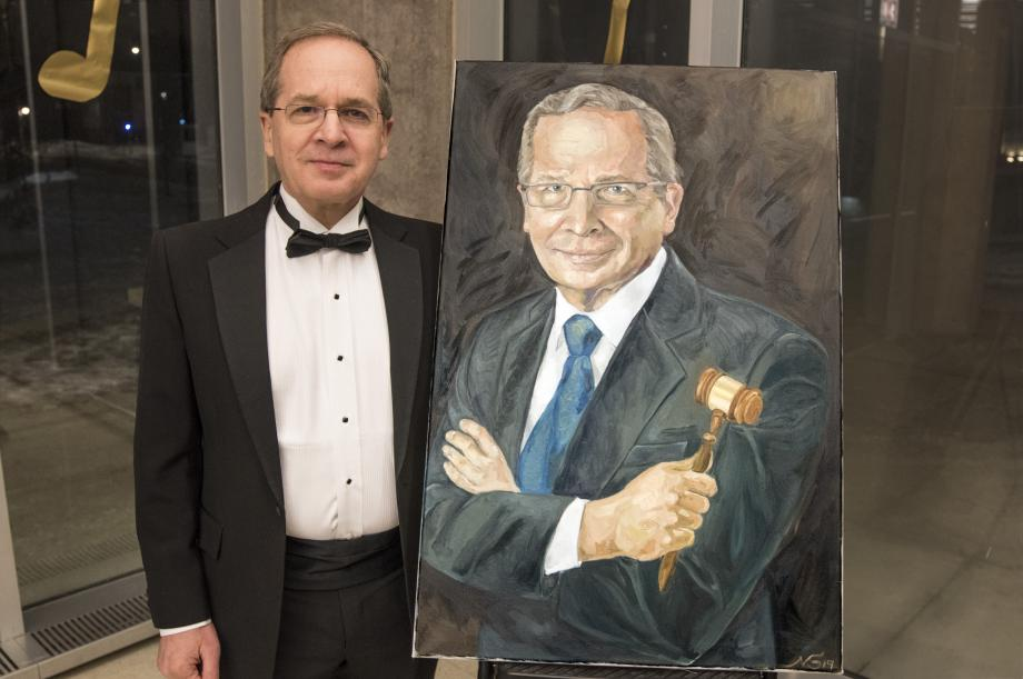 A painting of Professor Douglas Baird by Naama Shemesh, '20, was among the items sold in the silent auction.