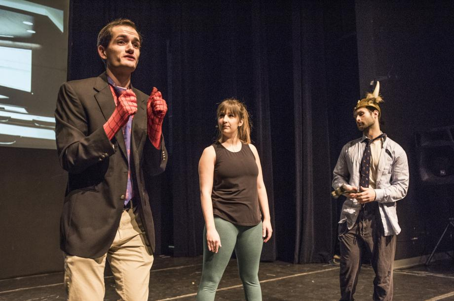 In this scene, Spider-Hemel (played by Chris Hurley, '19), Green Intern (played by Allie Van Dine, '20), and RappaThor (played by Seth Cohen, '20) argue about who should be Supreme Court Justice Ruth Bader Ginsburg's next clerk.