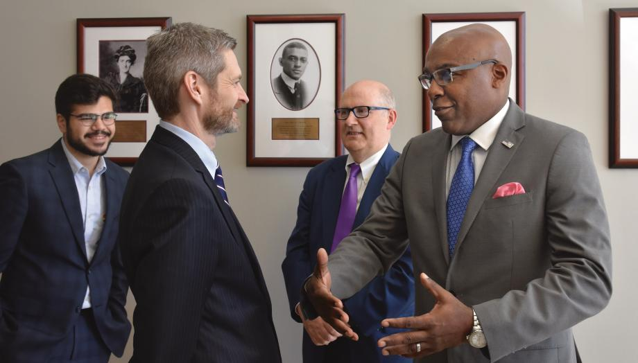 Miles, Illinois Attorney General Kwame Raoul, Adam Hassanein, and Deputy Dean Richard McAdams