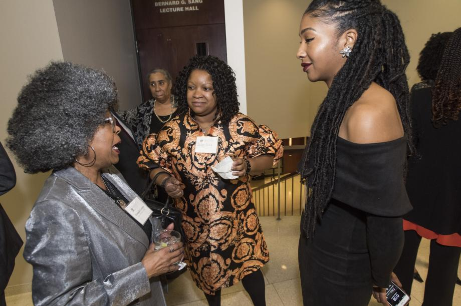 The event drew members of the judiciary, including Cook County Circuit Judges Erika Orr (center), seen talking with Professor Herschella Conyers and Savannah West, '20.
