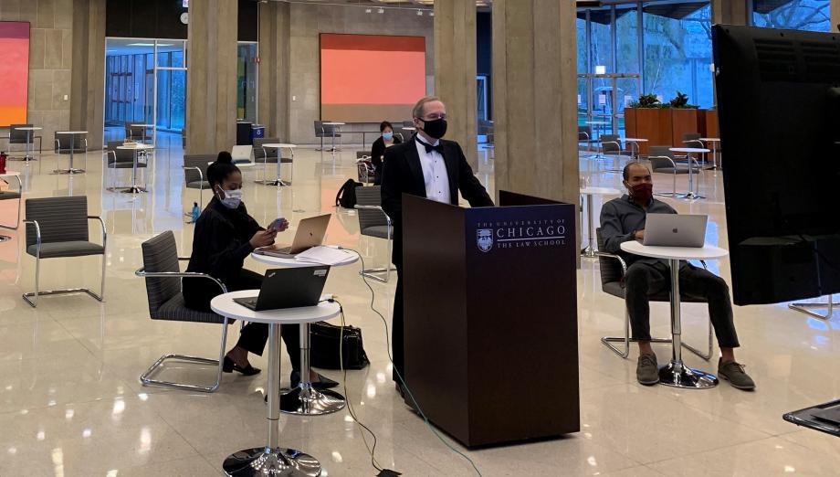 In keeping with tradition, Professor Douglas Baird presided over the live auction—auctioning items in front of a camera in the Green Lounge while participants bid via Zoom.