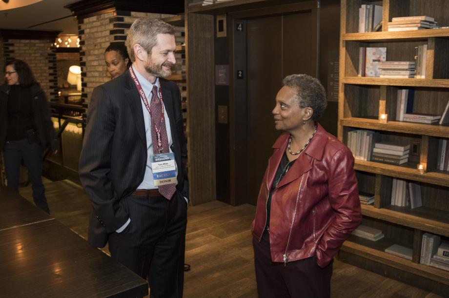 Dean Thomas J. Miles and Chicago Mayor-Elect, Lori Lightfoot, '89, chat at her class dinner.
