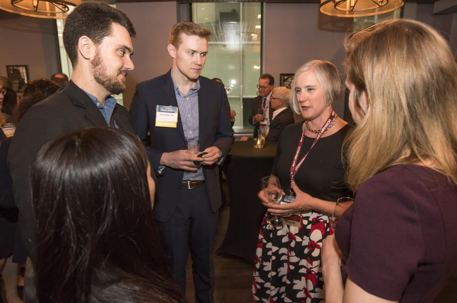 Tacy Flint, '04, spoke with current students at the clerkship reception.