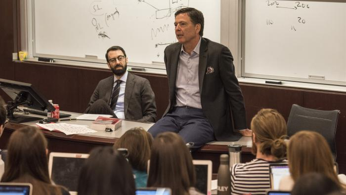 Comey speaks to law school students during criminal proceedings.