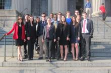 spring break of service students on courthouse steps
