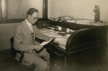 Dickerson seated at a desk
