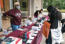 Students shopping for course books outside the Law School